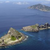 A group of disputed islands, Uotsuri island (top), Minamikojima (bottom) and Kitakojima, known as Senkaku in Japan and Diaoyu in China is se