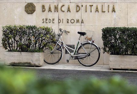 A bicycle is parked in front of a Bank of Italy sign in Rome October 31, 2013. REUTERS/Alessandro Bianchi