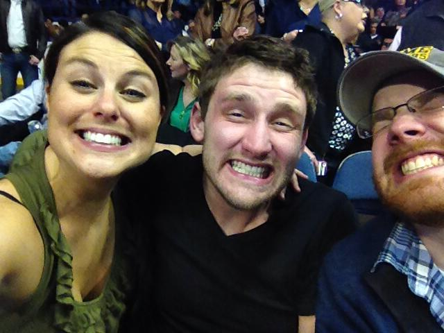 Jess, her boyfriend Mike and Jon smiling hard for George Strait (aka the Jon Henseler smile).