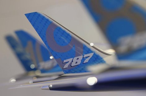 The tailwing of a model Boeing 787 Dreamliner aircraft is pictured at the Boeing booth at the Singapore Airshow February 11, 2014. REUTERS/E