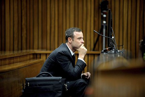 Olympic and Paralympic track star Oscar Pistorius listens to a witness testifying at the North Gauteng High Court in Pretoria March 10, 2014