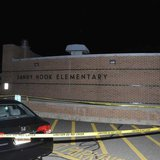 The car driven by Adam Lanza is pictured at Sandy Hook Elementary School in Newtown, Connecticut, in this evidence photo released by the Con