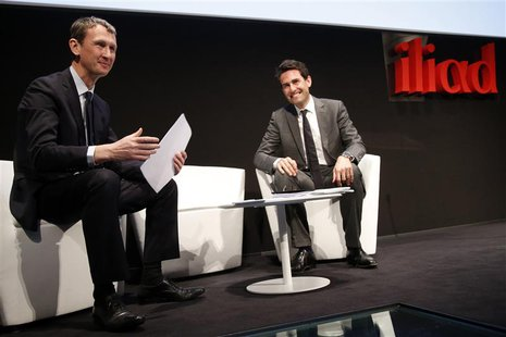 Maxime Lombardini (L), Chief Executive Officer of French broadband Internet provider Iliad, and Thomas Reynaud, Chief Financial Officer of I