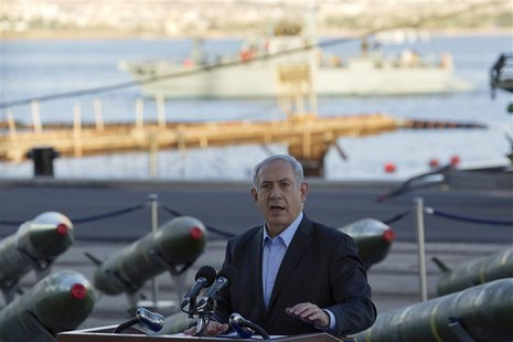 Israel's Prime Minister Benjamin Netanyahu speaks to the media in front of a display of M302 rockets, found aboard the Klos C ship, at a nav