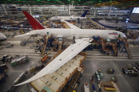 Workers at South Carolina Boeing work on a 787 Dreamliner for Air India at the plant's final assembly building in North Charleston, South Ca