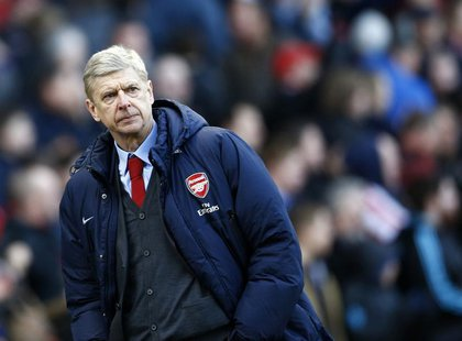 Arsenal manager Arsene Wenger walks off the pitch following their English Premier League soccer match defeat to Stoke City at the Britannia