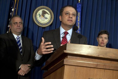 U.S.Attorney Preet Bharara speaks to media during a press conference announcing two felony charges against JPMorgan Chase Bank during a pres