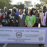 The Rev. Al Sharpton (C) links arms with Sybrina Fulton (L, dark glasses), the mother of slain teen-ager Trayvon Martin, and Phyllis Giles,