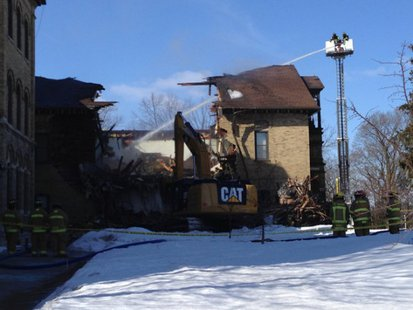 Crews tear down part of St. Joseph Hall on the St. Lawrence Seminary campus in Mount Calvary on Mar. 8, 2014. (Photo from: FOX 11).