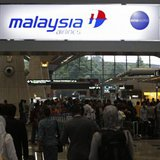 Passengers queue up at the Malaysia Airlines ticketing booth at the Kuala Lumpur International Airport in Sepang March 9, 2014.  CREDIT: REUTERS/EDGAR SU