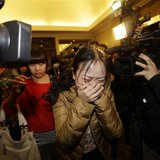 A relative (front) of a passenger of Malaysia Airlines flight MH370 cries as she walks past journalists at a hotel in Beijing March 9, 2014. Credit: REUTERS/Jason Lee