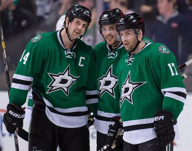 Mar 6, 2014; Dallas, TX, USA; Dallas Stars center Tyler Seguin (91) celebrates his hat trick with left wing Jamie Benn (14) and center Rich