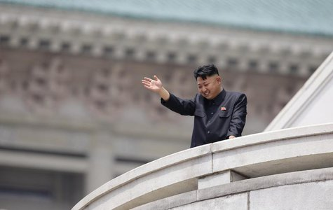 North Korean leader Kim Jong-un waves to the people during a parade to commemorate the 60th anniversary of the signing of a truce in the 195