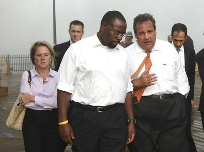 New Jersey Governor Chris Christie (R) talks with Department of Community Affairs Commissioner Richard Constable and CEO of the New Jersey E