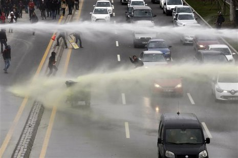 Riot police use water cannon to disperse anti-government protesters near the Middle East Technical University (ODTU) in Ankara March 11, 201