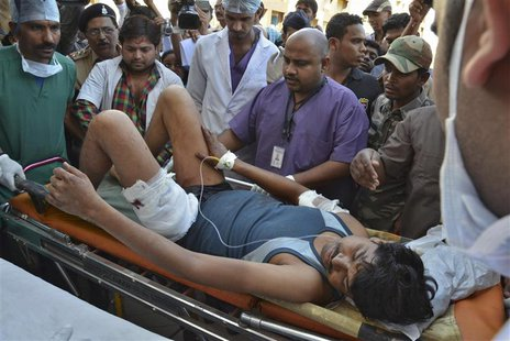 An injured Indian Central Reserve Police Force (CRPF) personnel is taken to a hospital at Raipur in the eastern Indian state of Chhattisgarh
