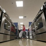 A woman walks by stoves in the appliance section at a Sears store in Schaumburg, Illinois near Chicago in this file photo taken September 23