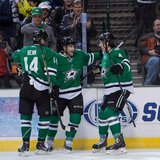 Jan 23, 2014; Dallas, TX, USA; Dallas Stars left wing Jamie Benn (14) and center Rich Peverley (17) and defenseman Brenden Dillon (4) celebr