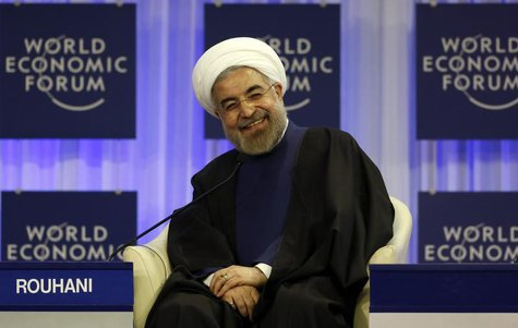Iran's President Hassan Rouhani smiles during a session at the annual meeting of the World Economic Forum (WEF) in Davos January 23, 2014. R