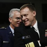 U.S. Navy Vice Admiral Michael Rogers (R) and U.S. Air Force General Paul Selva chat before giving testimonies at the Senate Armed Services
