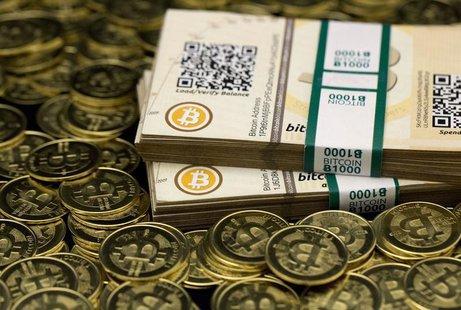 "Some of Bitcoin enthusiast Mike Caldwell's coins and paper vouchers, often called ""paper wallets"", are pictured at his office in this photo"