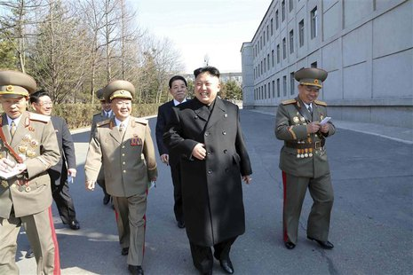 North Korean leader Kim Jong Un (C) visits the Kim Il Sung University of Politics to take part in the election of a deputy to the Supreme Pe