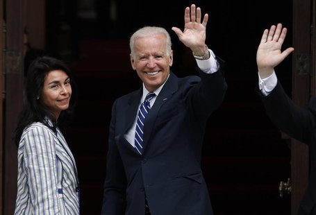 U.S. Vice President Joe Biden (C) waves to the media before a meeting with Chile's President-elect Michelle Bachelet (not pictured) in Santi