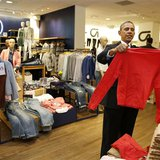 U.S. President Barack Obama looks for gifts for his family with salesperson Susan Panariello after stopping off at the GAP in New York, Marc