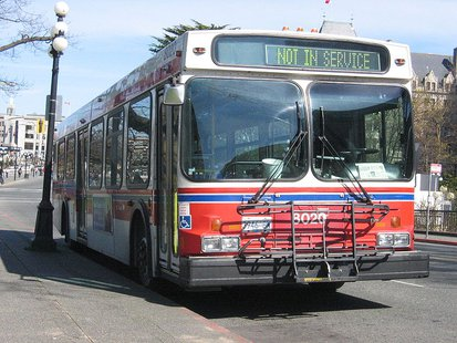 City bus (A New Flyer D40LF with bike rack, during a layover via WikiCommons.com)
