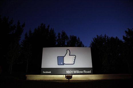 The sun rises behind the entrance sign to Facebook headquarters in Menlo Park before the company's IPO launch, May 18, 2012 file photo. REUT