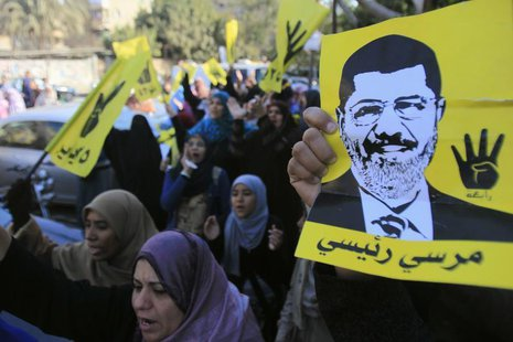 Supporters of the Muslim Brotherhood and ousted Egyptian President Mohamed Mursi shout slogans against the military and interior ministry wh