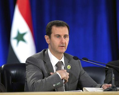 Syria's President Bashar al-Assad speaks during his meeting with the leadership al-Baath party of Damascus countryside,in Damascus March 8,