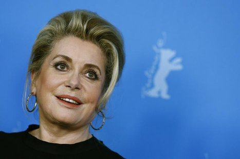 "Cast member Catherine Deneuve poses during a photocall to promote the movie ""Dans La Cour (In the Courtyard)"" at the 64th Berlinale Internat"