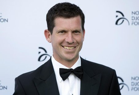Former tennis player Tim Henman poses for photographers as he arrives at a fundraising dinner for the Novak Djokovic Foundation in London Ju