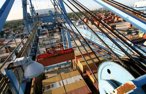 Crews load and unload consumer products at the Port of New Orleans along the Mississippi River in New Orleans, Louisiana June 23, 2010. REUT