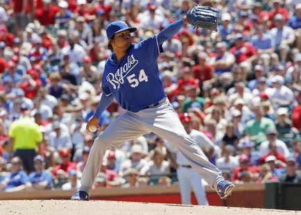 Kansas City Royals pitcher Ervin Santana throws against the Texas Rangers in the second inning of their MLB American League baseball game in