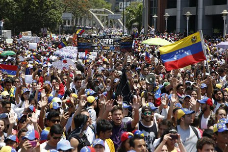 Anti-government protesters march during a demonstration in Caracas March 12, 2014.REUTERS/Carlos Garcia Rawlins