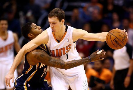 Jan 22, 2014; Phoenix, AZ, USA; Phoenix Suns guard Goran Dragic (right) controls the ball against Indiana Pacers forward Paul George in the