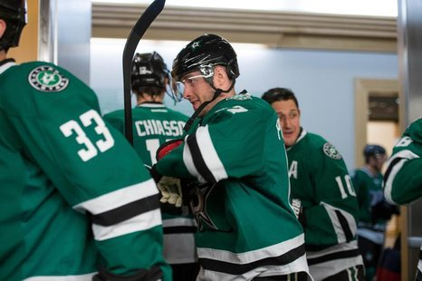 Mar 10, 2014; Dallas, TX, USA; Dallas Stars center Rich Peverley (17) and defenseman Alex Goligoski (33) and defenseman Trevor Daley (6) tak