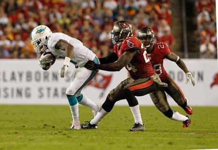 Nov 11, 2013; Tampa, FL, USA; Tampa Bay Buccaneers cornerback Darrelle Revis (24) tackles Miami Dolphins wide receiver Mike Wallace (11) dur