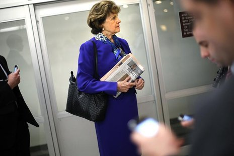 U.S. Senator Dianne Feinstein (D-CA) waits for a subway car with aides as she returns to her office after a floor speech aimed at the CIA's