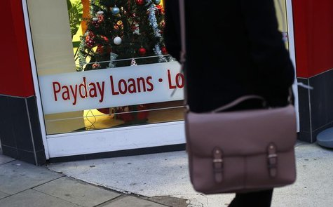A payday loans sign is seen in the window of Speedy Cash in northwest London November 25, 2013. REUTERS/Suzanne Plunkett