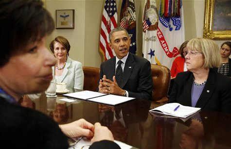 U.S. President Barack Obama speaks to female members of Congress about his administration's minimum wage efforts in the Roosevelt Room at th