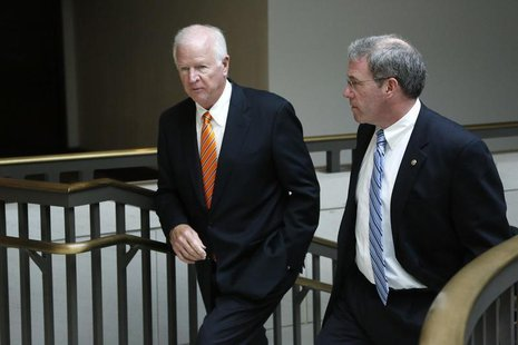 U.S. Senator Saxby Chambliss (R-GA) (L), vice chairman of the Senate Select Committee on Intelligence, and Senator Jeffrey Chiesa (R-NJ) dep
