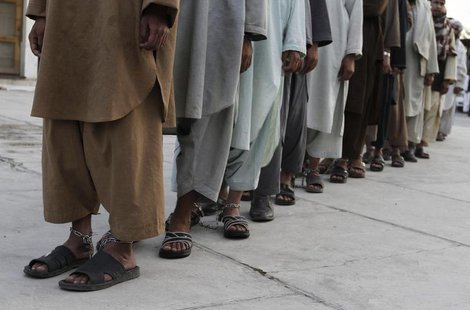 Prisoners who escaped from Kandahar's Sarposa jail on Monday are presented to the media after they were recaptured, in Kandahar April 26, 20