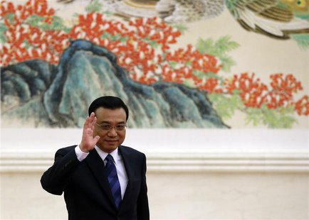 China's Premier Li Keqiang waves as he arrives for a news conference, after the closing ceremony of the Chinese National People's Congress (