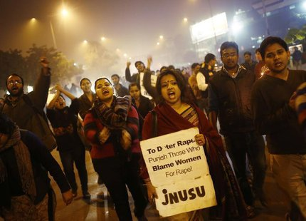 Demonstrators shout slogans during a candlelight vigil to mark the first anniversary of Delhi gang rape, in New Delhi December 16, 2013. A 2