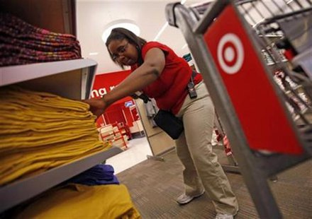 An employee at the new CityTarget store checks stock on the shelves during preparations for its opening in downtown Chicago July 18, 2012. R