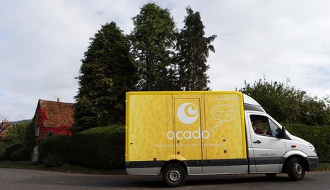 An Ocado delivery truck drives through Fingest in southern England October 8, 2013. REUTERS/Suzanne Plunkett