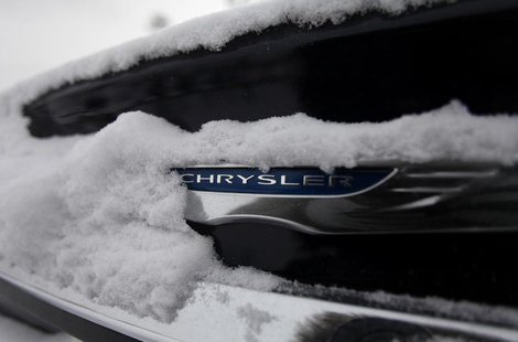 Snow surrounds the Chrysler logo displayed on a vehicle in the parking lot at Bill Snethkamp dealership in Detroit, Michigan January 2, 2014